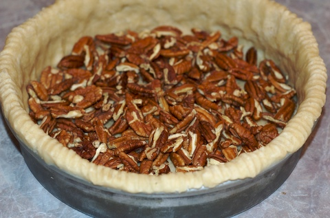 Pecan quarters in pie crust