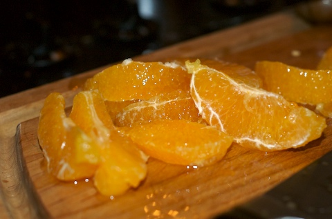 Zest the orange peel into the sauce and reserve the slices