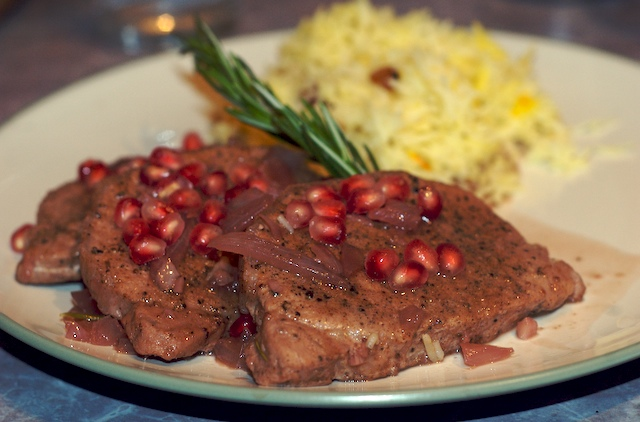 Slices of pork tenderloin with pomegranate sauce