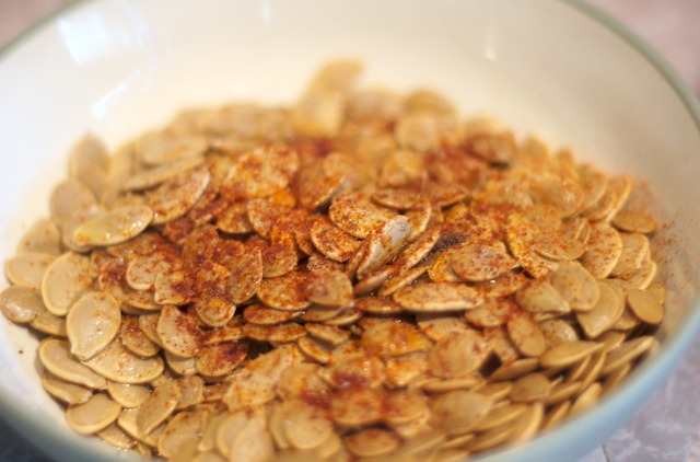 Oil and spice up the pumpkin seeds