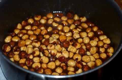 Coat the toasted hazelnuts in warm caramel sauce