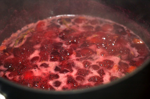 Simmer as the berries burst and the sauce thickens