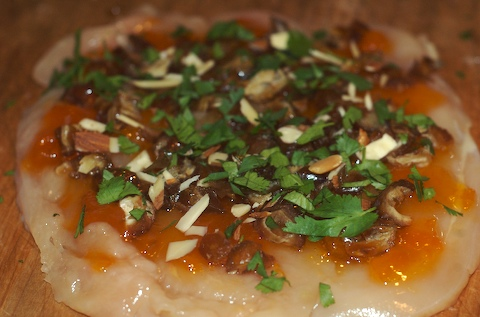Top the chicken with apricot, dates, almonds, and cilantro