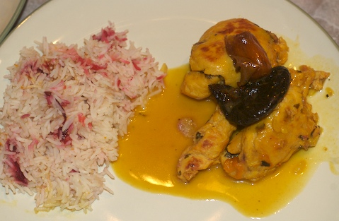 Chicken Poached in Saffron Cream Sauce topped w/date & fig, served w/cranberry rice