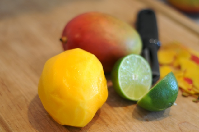 Peel and pit mangos, slice lime