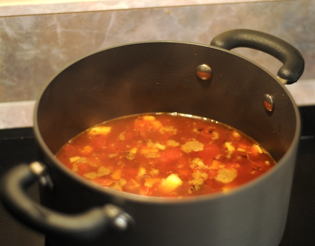 Simmer in broth and tomato