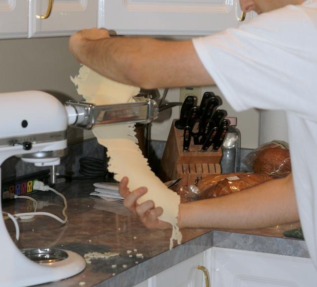 Carefully put the dough through the roller