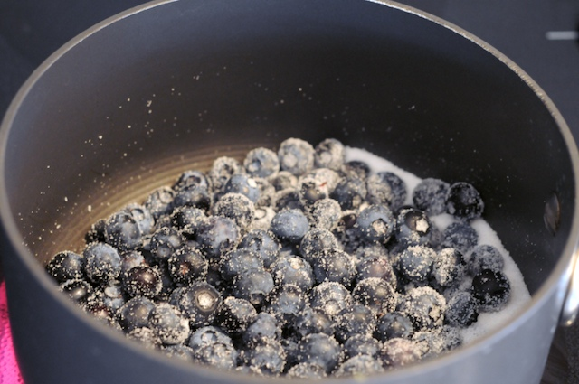 Heat the blueberries in sugar
