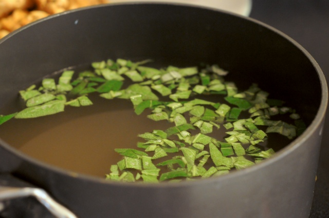 Warm the broth and add the diced sage leaves so that it can flavor the broth while you work
