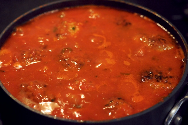Simmer the meatballs in the tomato sauce to cook all the way through
