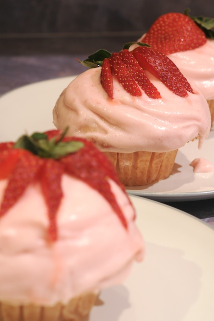 Strawberry Rhubarb Jam Filled Strawberry Cupcakes with Strawberry Frosting and some indecisively placed strawberry garnish. I hate strawberries ;-)