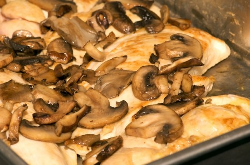 Browned chicken topped with sautéed mushrooms