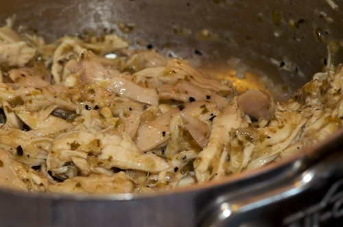 Toss shredded chicken in a bit of the verde sauce to season and rewarm