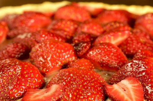 Decorate the top with strawberries and glaze them with melted syrup/jelly for that wet shine