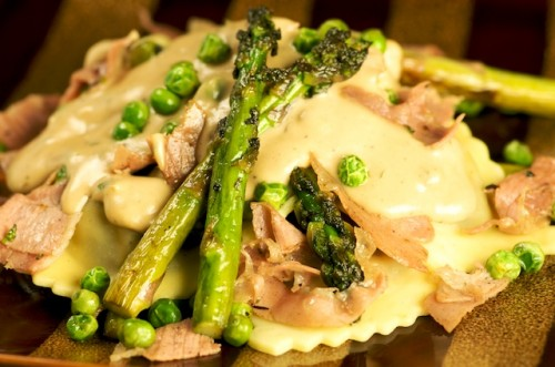 Mushroom Agnolotti with Peas, Asparagus, Prosciutto, and a Goat Cheese Cream Sauce