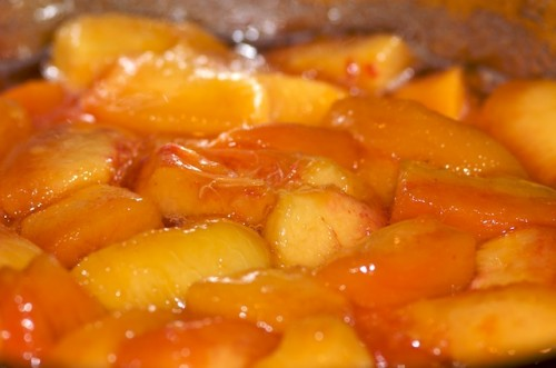 Plump the peaches in sugar